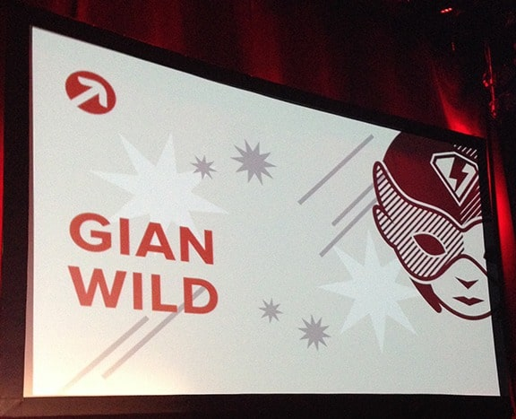 The text Gian Wild on the big screen next to a female superhero